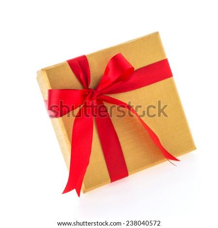 Christmas gold gift box isolated on white background - stock photo
