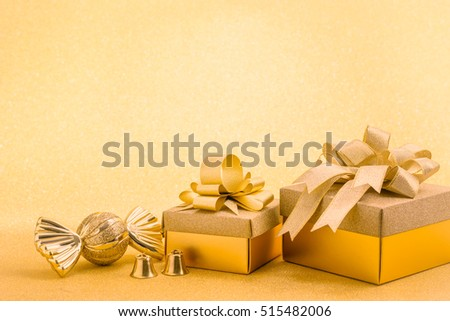 Christmas gold gift box on yellow background