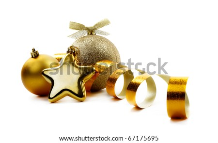 Christmas golden balls hanging with ribbons on white background - stock photo