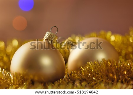 Christmas golden balls on abstract brown background.  Xmas card concept.