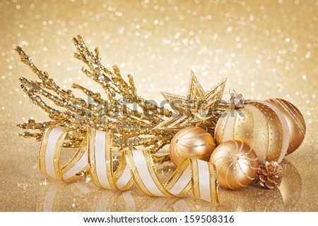 Christmas golden decoration  with balls and ribbon - stock photo
