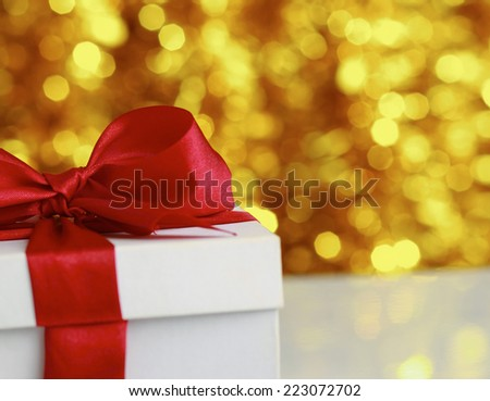 christmas golden gift on a furry background - stock photo