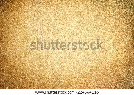 Christmas Golden Glittering background.Holiday Gold abstract texture. Bokeh  - stock photo