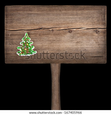 Christmas green fir tree on a wooden board. New Year background - stock photo