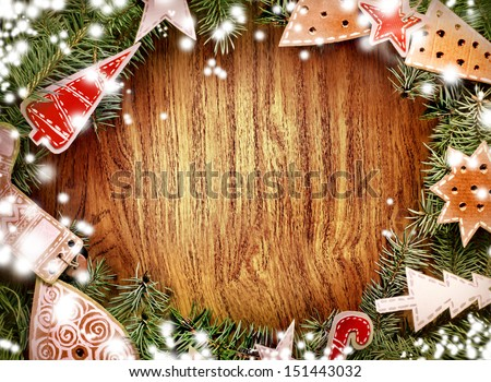 Christmas green framework with christmas decorations/ Wooden frame with Christmas tree branches and vintage decorations - stock photo