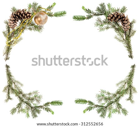 christmas greeting card frame - spruce tree branches with cones and gold ball on white background - stock photo
