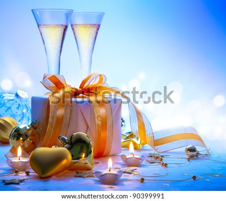 Christmas greeting card ( glasses of champagne vine and Christmas gifts, New Year party ) - stock photo