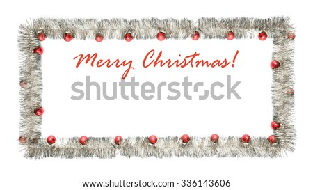 Christmas greeting card made of silver tinsel frame with red christmas balls with copy space - stock photo