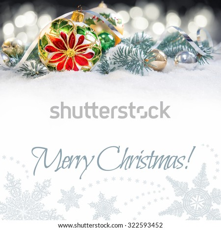 Christmas greeting card or border. Glass bauble with poinsettia, decorated branches of Christmas tree on snow. Isolated on white, space for your text - stock photo