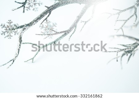 Christmas Greeting Card. Silver Branch and Metallic Snowflakes over Light Background. Selective Focus. Space for Text.  - stock photo