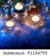 christmas greeting card with christmas candle decoration and christmas decoration on blue background - stock photo