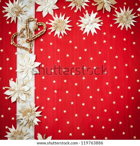 Christmas greeting card with Christmas decorations on a red background with stars - stock photo