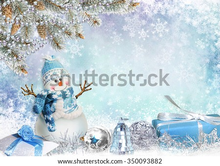Christmas greeting card with pine branches, snowman and gifts - stock photo