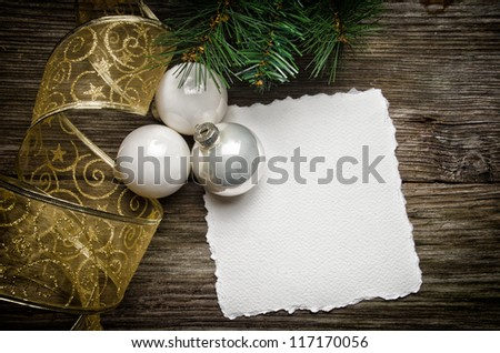 Christmas greeting card with white ornaments and golden ribbon - stock photo