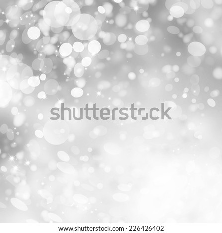 Christmas Grey Background. Silver Holiday Abstract Glitter Defocused Background With Blinking Stars and Snowflakes. Snow Blurred Bokeh  - stock photo