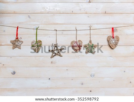christmas handmade toys on light wooden background with text space