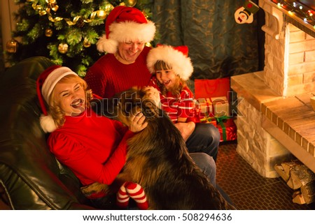 Christmas happy family of parents, child and dog