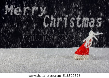 Christmas-hats and snow falling from the sky