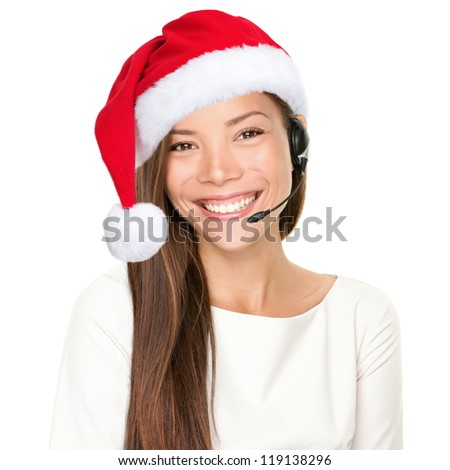 Christmas headset woman from telemarketing call center wearing red santa hat talking smiling isolated on white background. - stock photo