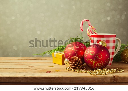 Christmas holiday background with checked cup and decorations - stock photo