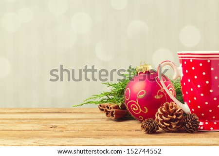 Christmas holiday background with coffee cup, pine corn and ornaments - stock photo