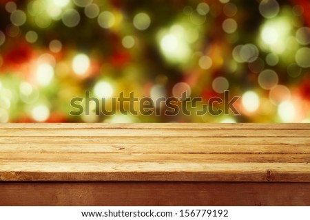 Christmas holiday background with empty wooden deck table over festive bokeh. Ready for product montage - stock photo