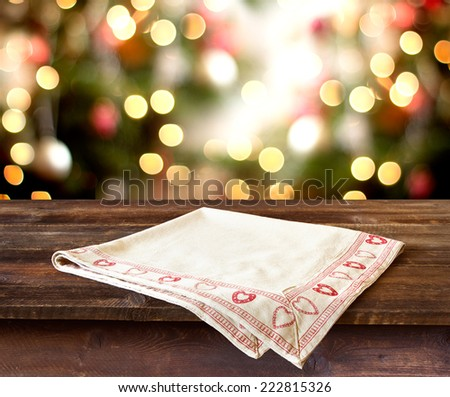 Christmas holiday background with rustic table over christmas bokeh for product montage - stock photo