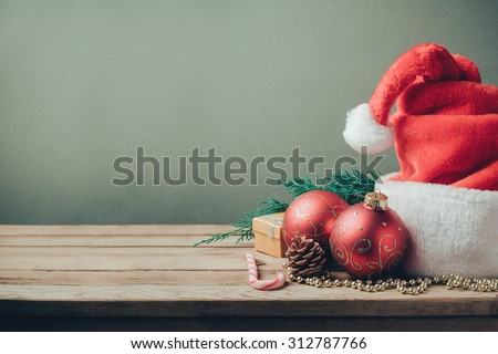 Christmas holiday background with Santa hat and decorations. Retro filter effect - stock photo