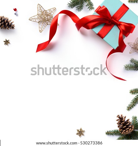 Christmas holiday composition; Christmas gift, fir tree branches and Christmas ornament on white background. Flat lay; top view.