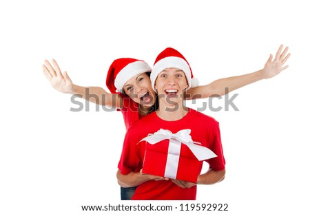 christmas holiday couple couple love smiling with hands outstretched lifted upwards, man and woman being playful smile wear red shirts and new year hat, isolated over white background - stock photo