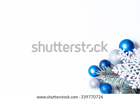 Christmas holiday decoration. Blue ornament bauble with branch of fir, pine and snowflake on white background. Festive merry xmas, new year celebration. Golden decorative ball.  - stock photo