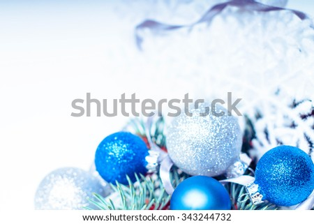 Christmas holiday decoration. Blue, white ornament bauble, snowflake with fir, pine branch background. Festive merry xmas, new year celebration. Golden shiny light  ball.