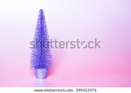 Christmas holiday decoration. Ornament tree with gold, pink, purple background. Festive merry xmas, new year celebration. Golden shiny light decorative closeup toys  - stock photo
