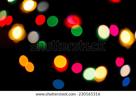 Christmas holiday garland with sparkling colorful blurred lights - stock photo
