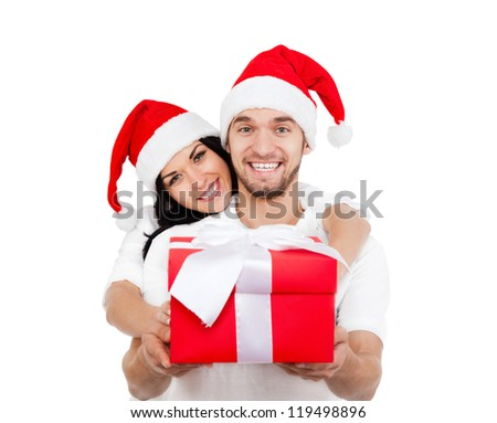 christmas holiday happy couple hold present gift box wear red new year santa hat cap, man and woman love smile looking at camera embracing, isolated over white background - stock photo