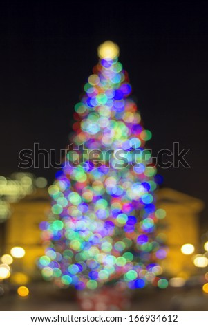Christmas Holiday Tree at Pioneer Courthouse Square in Portland Oregon Downtown Blurred Defocused Bokeh Colorful Lights at Night - stock photo
