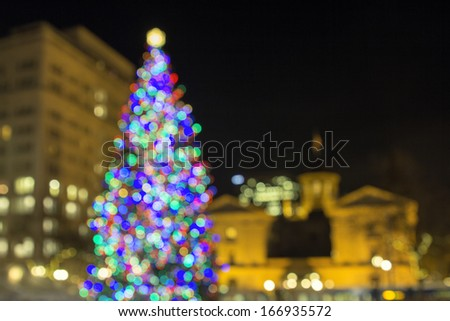 Christmas Holiday Tree at Pioneer Courthouse Square in Portland Oregon Downtown with Blur Defocused Bokeh Colorful Lights at Night - stock photo