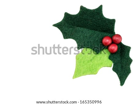 Christmas holly with with red berries isolated on a white background as a winter holiday symbol and seasonal decoration. - stock photo