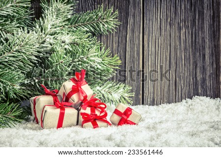 Christmas home decoration with small gifts and spruce branch - stock photo