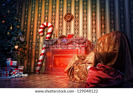Christmas home decoration with tree, gifts and fireplace. - stock photo