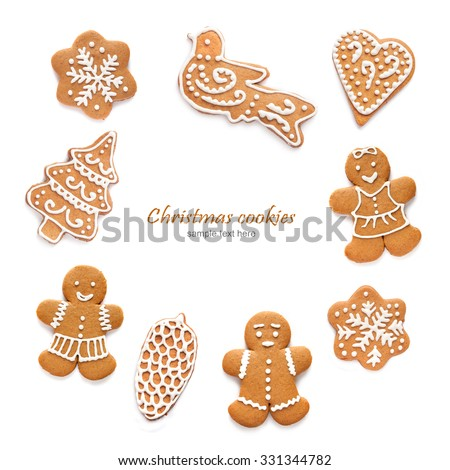 Christmas homemade gingerbread cookies on the white background - stock photo
