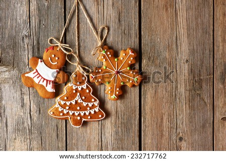 Christmas homemade gingerbread cookies over wooden background - stock photo