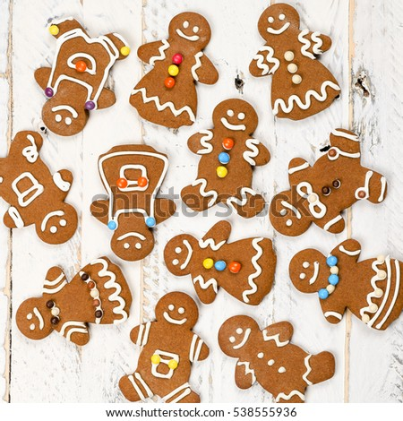 Christmas homemade gingerbread man family cookies couples on white wooden table background