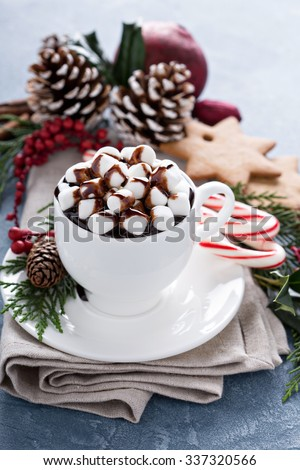 Christmas hot chocolate with ornaments and candy cane