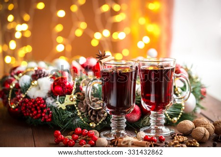 Christmas hot mulled wine with spices on a wooden table. The idea for creating greeting cards - stock photo