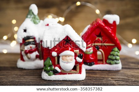 Christmas houses decorations and candle holders with festive lights  - stock photo