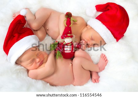 Christmas image of newborn twin babies of 11 days old - stock photo