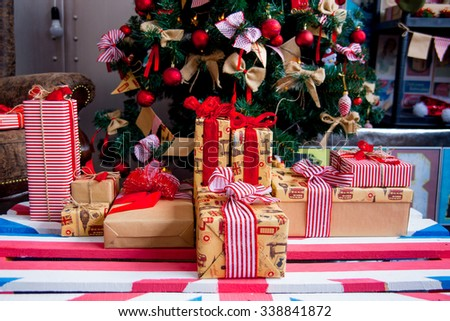 Christmas interior in red flowers with gifts - stock photo