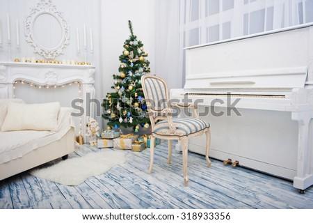 Christmas interior room with sofa, fir tree and piano - stock photo