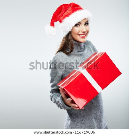 Christmas isolated woman portrait hold red christmas gift. Smiling happy girl on white background.